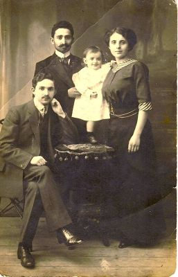Avraham & Esther, baby Haim and uncle Charles Szeflan, Siedlce 1910